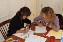 Acadia Center English immersion course students at work in the study center at Acadia Center in Camden, Maine.